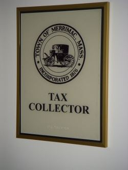 Tax Collector Sign Hanging on Wall